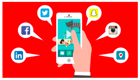 Hand holding a mobile that shows the most common social media icons