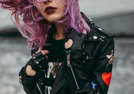 Cool girl in leather jacket with pink hair posing